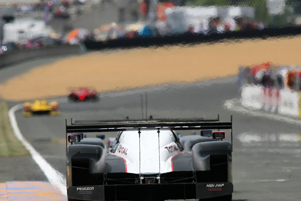 The two Peugeots chasing the #3 Audi - Chassis: 908-03 - Entrant: Team Peugeot Total  - 2007 24 Hours of Le Mans