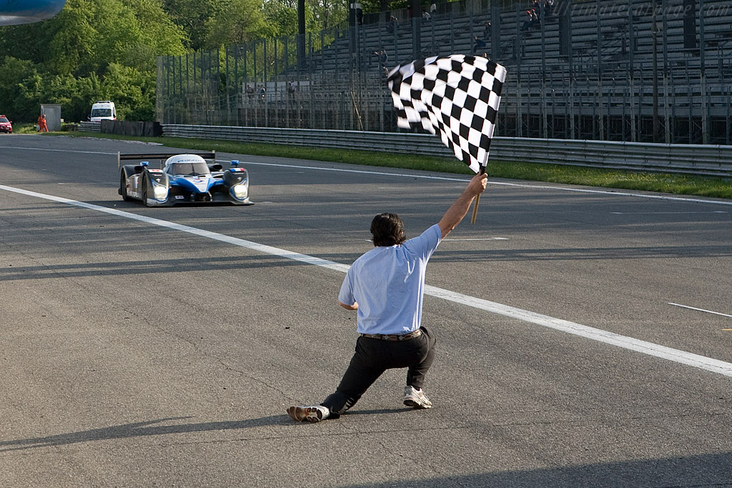 Pedro Lamy takes the flag - Chassis: 908-03 - Entrant: Team Peugeot Total - Driver: Pedro Lamy / Stephane Sarrazin  - 2008 Le Mans Series Monza 1000 km