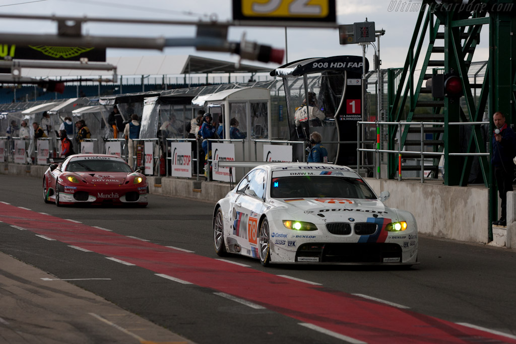 BMW and Ferrari on pit road - Chassis: 1001   - 2010 Le Mans Series Silverstone 1000 km (ILMC)