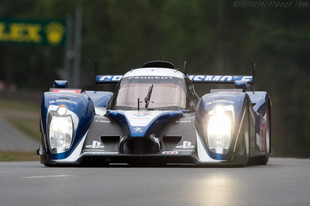 http://www.ultimatecarpage.com/images/large/4621/Peugeot-908_1.jpg